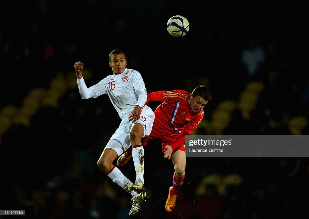 Bamidele Alli of England battles with Alexandr Golovin of Russia during the UEFA European Under-17 Championship Elite Round match between England Under-17 and Russia U-17at Pirelli Stadium on March 25, 2013 in Burton-upon-Trent, England.
