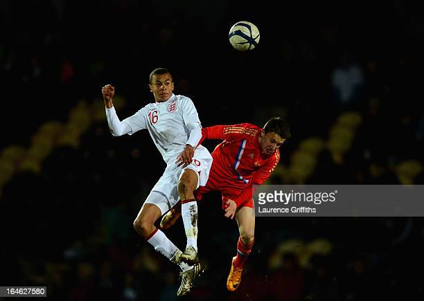 Bamidele Alli of England battles with Alexandr Golovin of Russia during the UEFA European Under17 Championship Elite Round match between England...