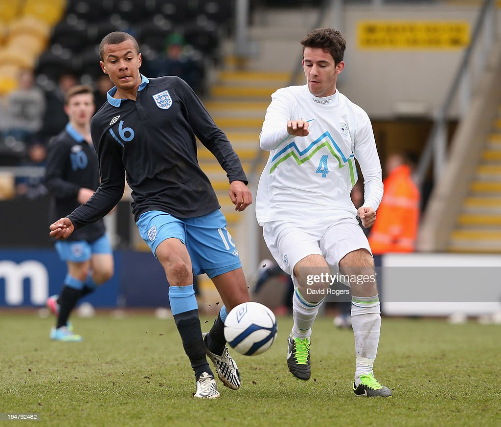 Bamidele Alli of England is challenged by Matic Zupanc during the UEFA European Under 17 Championship match between England and Slovenia at Pirelli Stadium on March 28, 2013 in Burton-upon-Trent, England.