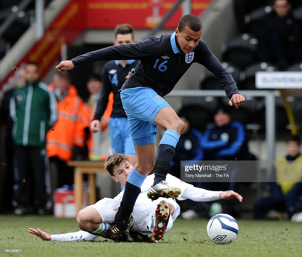 Bamidele Alli of England tackled by Jon Gorenc Stankovic of Slovenia during the England v Slovenia, UEFA European Under-17 Championship: Elite Round at Pirelli Stadium on March 28, 2013 in Burton-upon-Trent, England.