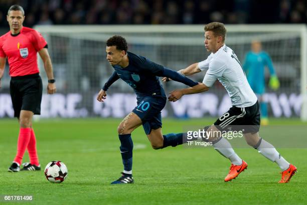 Bamidele Alli und Joshua Kimmich of Germany battle for the ball during the international friendly match between Germany and England at Signal Iduna...
