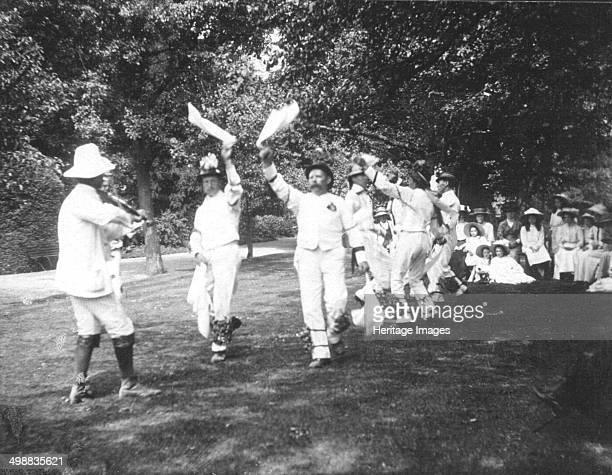 Bampton Morris Dancers Oxfordshire Whit Monday 5 June 1911 William Nathan Wells playing the fiddle Thomas Tanner and Joseph Rouse dancing Photograph...