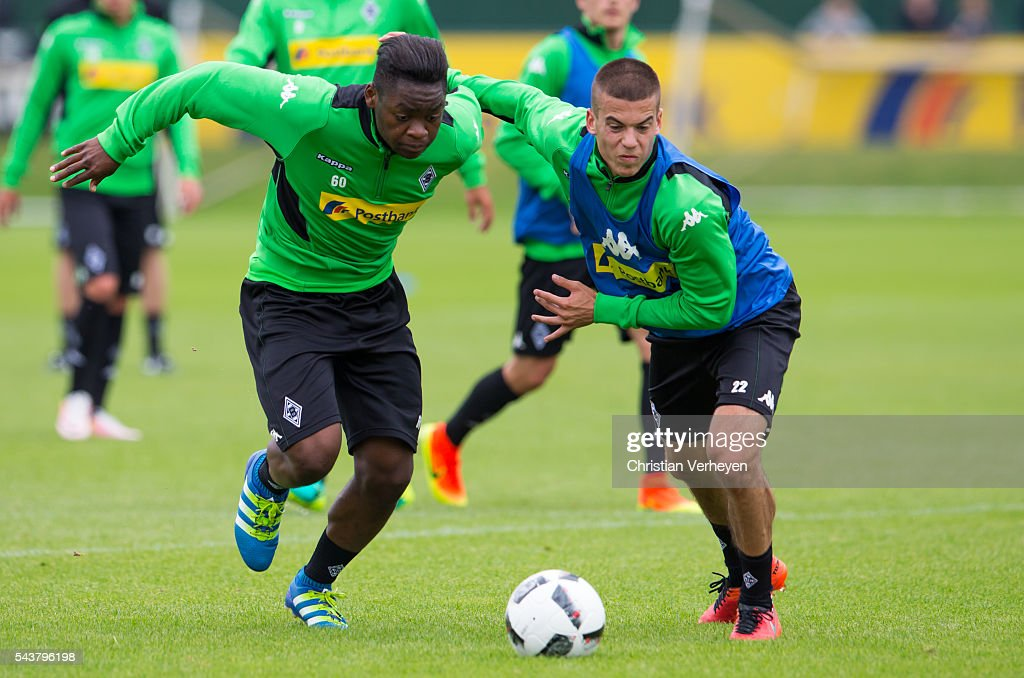 Ba-Muaka Simakala and Laszlo Benes battle for the ball during a training session at Borussia-Park on June 30, 2016 in Moenchengladbach, Germany.
