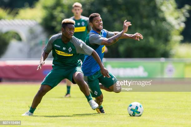 BaMuaka Simakala of Borussia Moenchengladbach and Kwame Yeboah of Borussia Moenchengladbach battle for the ball during a training session at the...