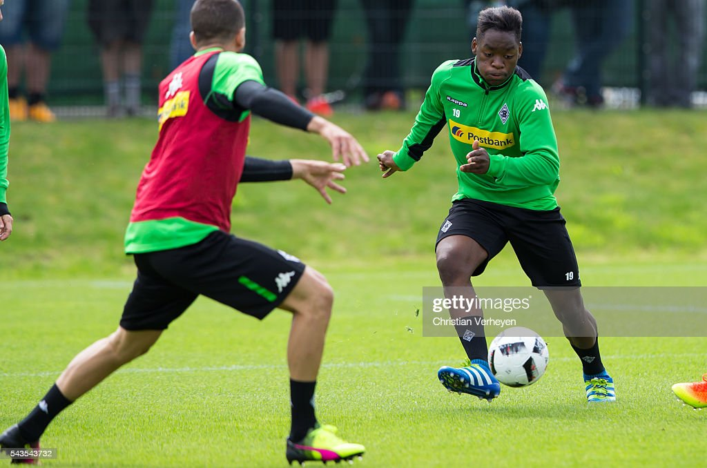 Ba-Muaka Simakala of Borussia Moenchengladbach controls the ball during a training session at Borussia-Park on June 29, 2016 in Moenchengladbach, Germany.