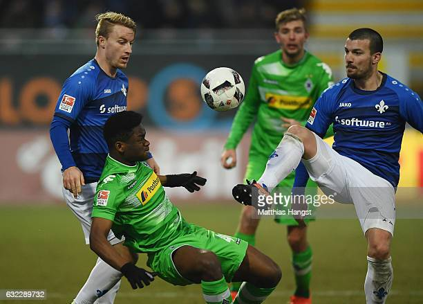 BaMuaka Simakala of Gladbach is challenged by Jerome Gondorf of Darmstadt during the Bundesliga match between SV Darmstadt 98 and Borussia...