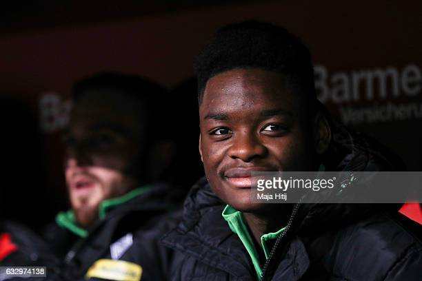BaMuaka Simakala of Moenchengladbach sits on the bench prior the Bundesliga match between Bayer 04 Leverkusen and Borussia Moenchengladbach at...