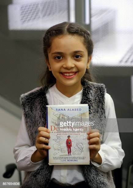 Bana Alabed the 8yearold Syrian girl who fled to Turkey from the wartorn Syrian city of Aleppo shows her book named 'Dear World A Syrian Girl's Story...