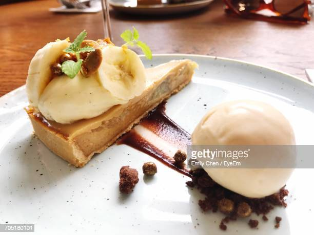 Banana Cake With Ice Cream In Plate On Table