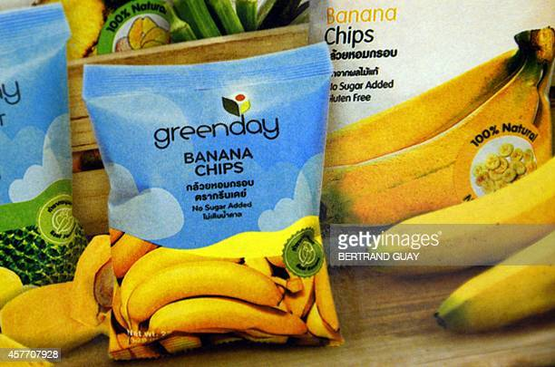 Banana chips marketed by Thai company Greenday are displayed at the Global Food Show on October 20 2014 in Villepinte northeast of Paris Once firmly...