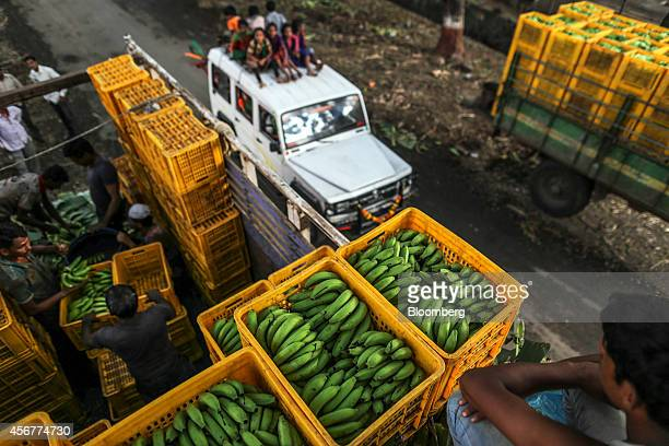 Banana hands sit in crates stacked on a truck during a harvest in Bhusawal Maharashtra India on Saturday Oct 4 2014 More than 75 percent of India got...