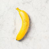 Banana on white marble table. Minimal flat lay