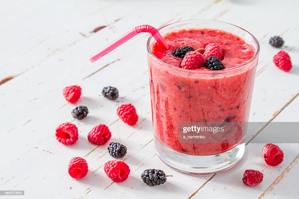 Banana, raspberry and blackberry smoothie,white wood background : Stock Photo