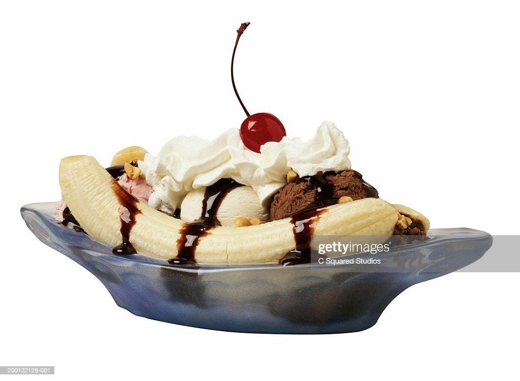Banana split in blue dish : Stock Photo