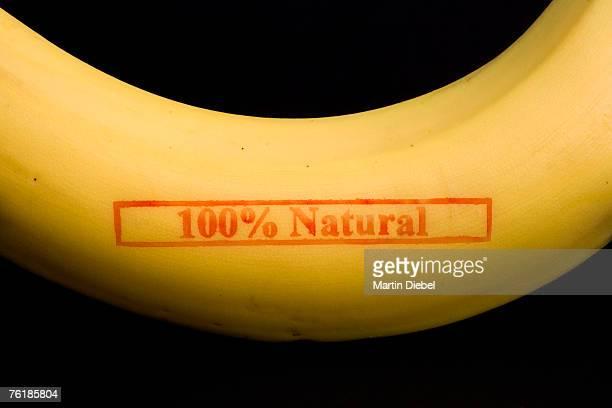 A banana stamped '100% Natural'