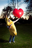 Banana Suit Man Holding A Heart