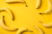 Top view of bananas isolated on yellow