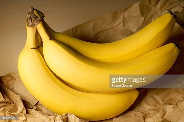 Bananas on brown paper bag