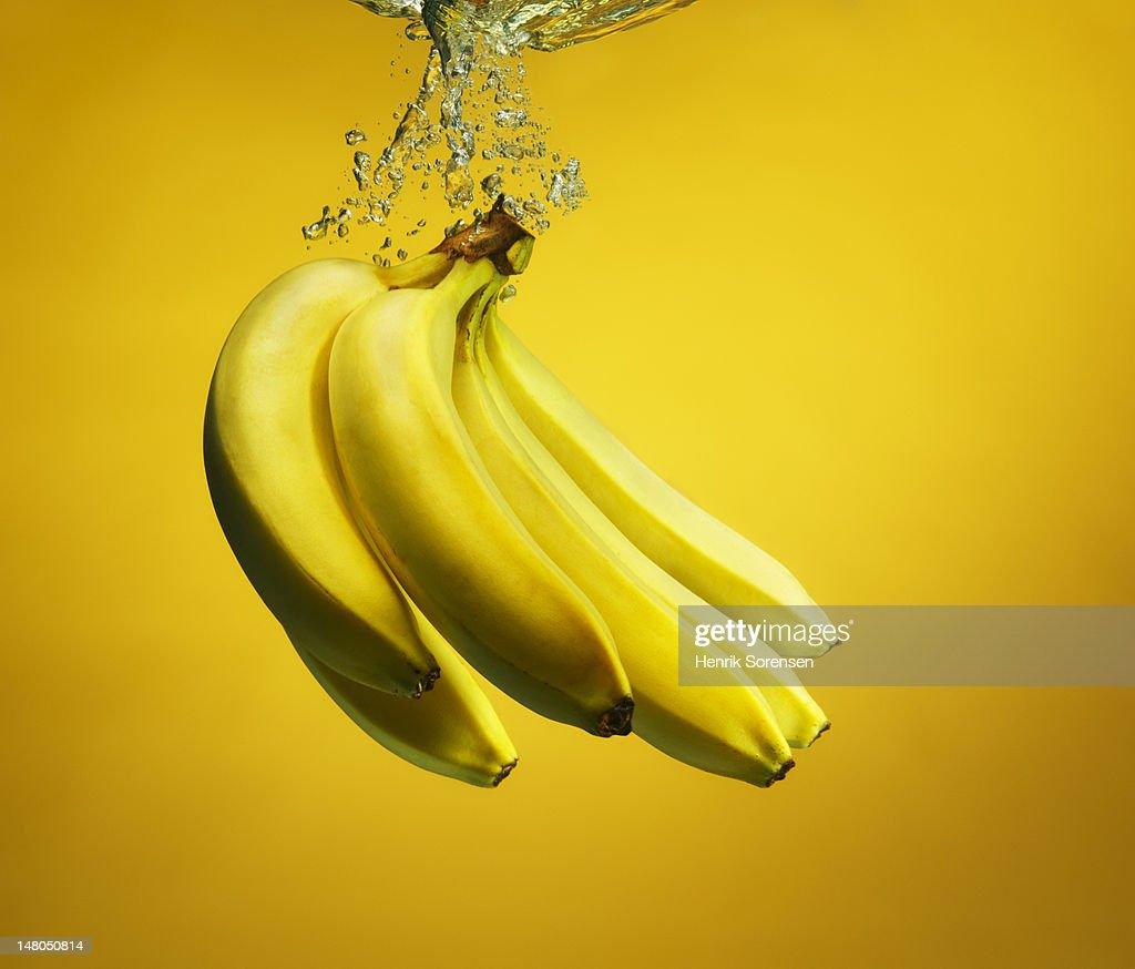bananas splashed into water