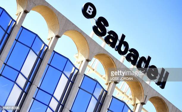 'Banc Sabadell' logo is pictured at the bank's new headquarters in Alicante on October 6 2017 Banc Sabadell Catalonia's secondbiggest bank said today...