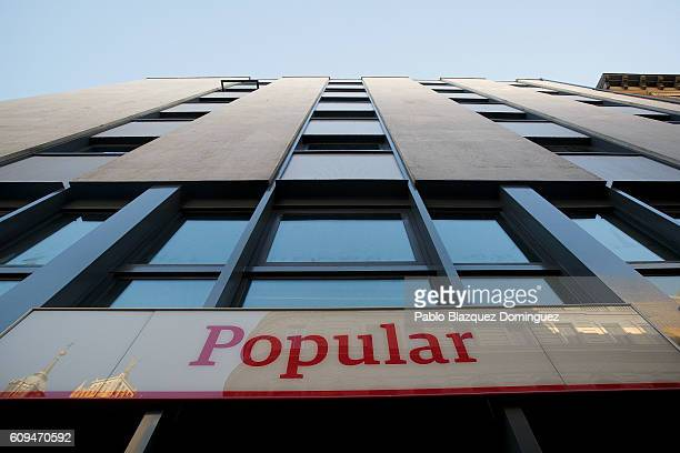 Banco Popular sign is displayed outside a branch on September 21 2016 in Madrid Spain Spain's Banco Popular plans to cut around 3000 jobs and close...