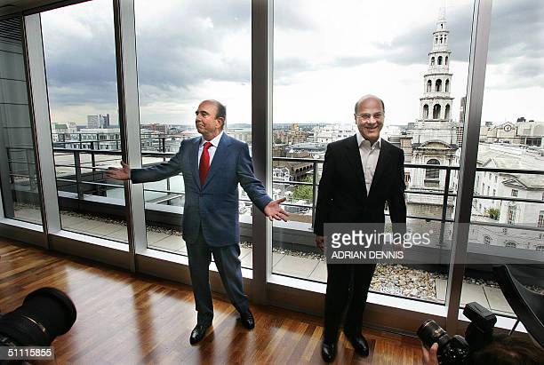 Banco Santander Central Hispano Chairman Emilio Botin gestures alongside Arnold Luqman Chief Executive of Abbey during a photocall in London 26 July...