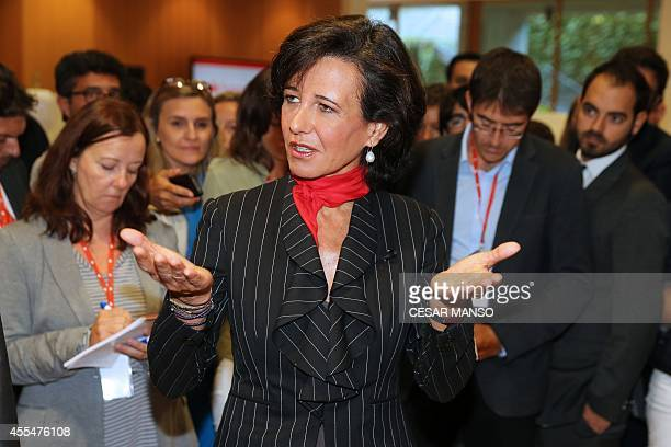 Banco Santander's new chairwoman Ana Patricia Botin speaks to journalists during the 2014 extraordinary general shareholders' meeting in the northern...