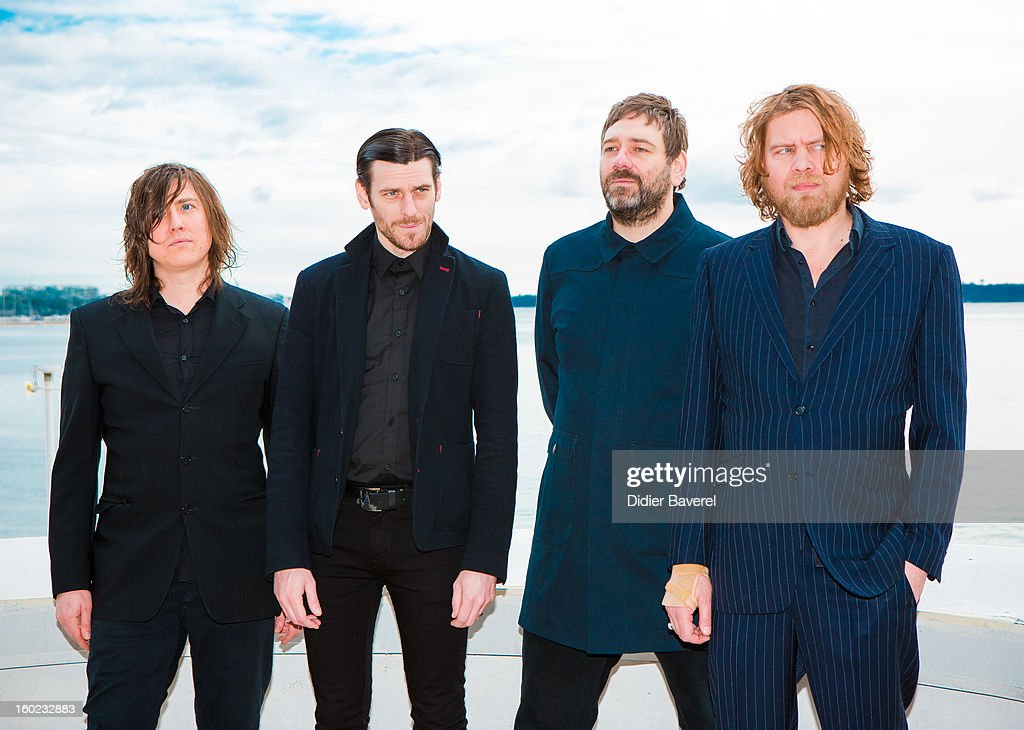 Band 'Archive' poses during the photocall of 47th Midem at Palais des Festivals on January 28, 2013 in Cannes, France.