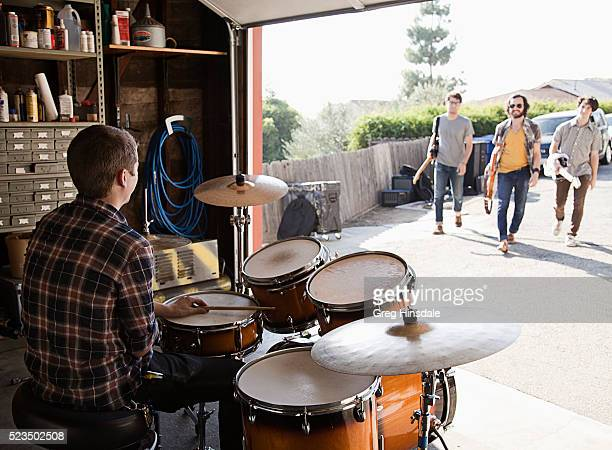 Band arriving at rehearsal in garage