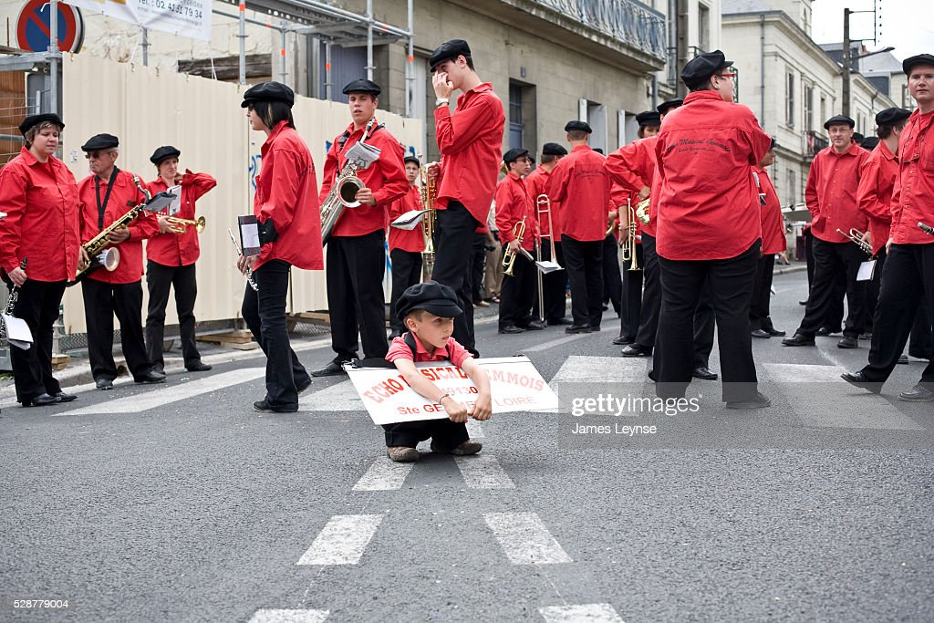 A band awaits the start of the 'Festival International des Geants et des Masques' a parade with floats in Saumur, France.
