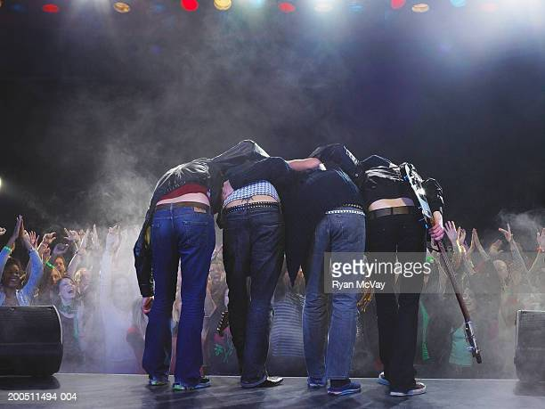 Band bowing to audience, rear view