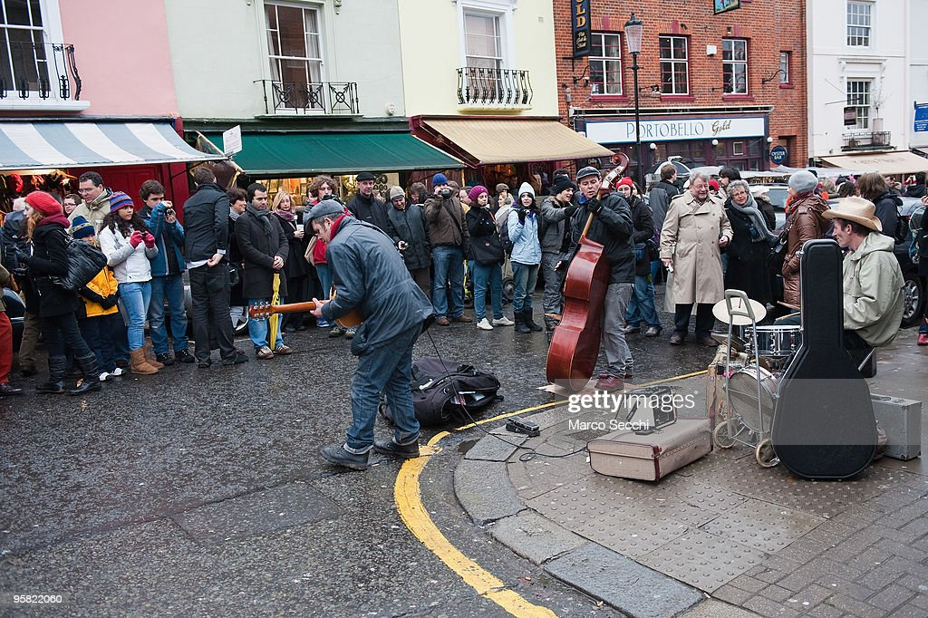 A band entertains the shoppers on a market day in Portobello Road on January 16, 2010 in London, England. Portobello traders fear for the Market's future after Lipka's Antiques Arcade, where more than 150 traders had their stalls, was redeveloped to accommodate a large High street chain store.