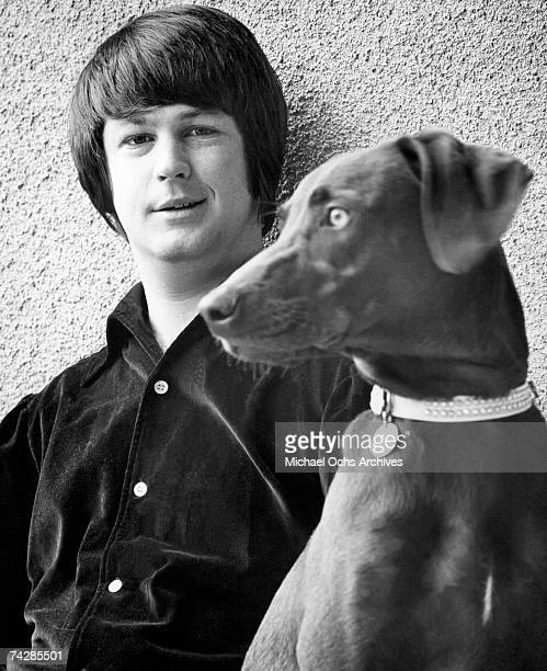 Band leader Brian Wilson of the rock and roll band 'The Beach Boys' poses for a portrait with his dog in circa 1965 in Los Angeles California