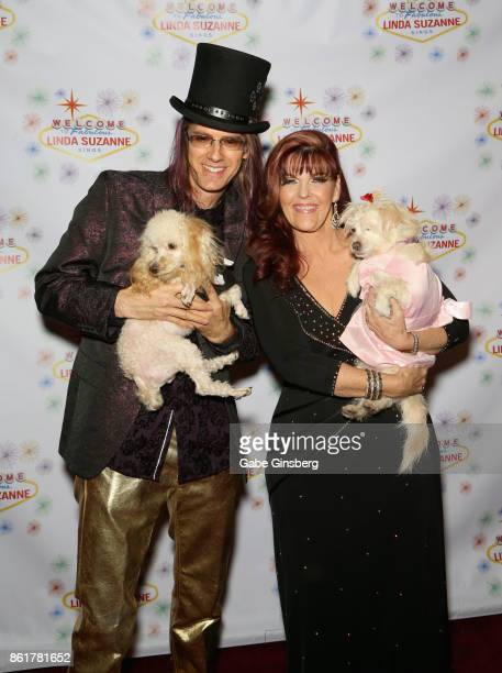Band leader John Wakerman and his wife singer Linda Suzanne pose with rescue dogs from Friends for Life Humane Society at the debut of 'Linda Suzanne...