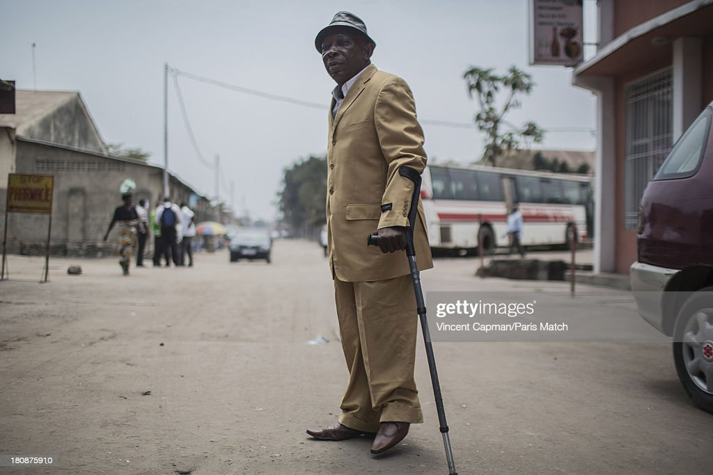 Band leader Papa Ricky of Staff Benda Bilili are photographed for Paris Match on August 27, 2013 in Kinshasa, Democratic Republic of Congo.