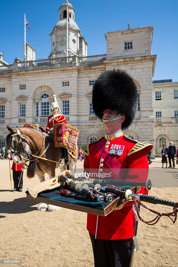 Band Master Will Casson-Smith (C) holding 100-year-old bagpipes poses at Horse Guards Parade on May 4, 2016 in London, England. The bagpipes belonged to a Pipe Major of the Regiment of the Argyll and Sutherland Highlanders who died after becoming ill in the trenches at the Battle of the Somme. The bagpipes were brought to Horse Guards Parade today for a performance to launch the Household Division's Beating Retreat concerts, which feature military drills, music and fireworks, taking place on the 8th and 9th of June.