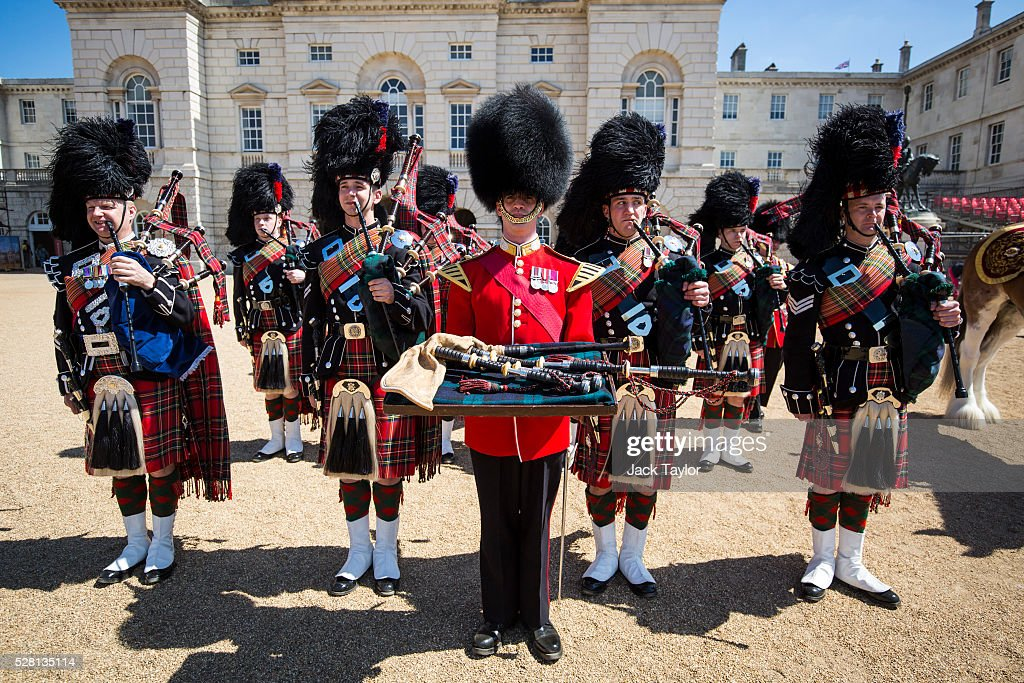Band Master Will Casson-Smith (C) holding 100-year-old bagpipes poses with Pipers from the Scots Guards at Horse Guards Parade on May 4, 2016 in London, England. The bagpipes belonged to a Pipe Major of the Regiment of the Argyll and Sutherland Highlanders who died after becoming ill in the trenches at the Battle of the Somme. The bagpipes were brought to Horse Guards Parade today for a performance to launch the Household Division's Beating Retreat concerts, which feature military drills, music and fireworks, taking place on the 8th and 9th of June.
