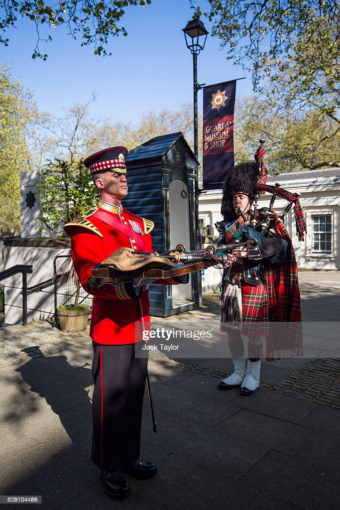 Band Master Will Casson-Smith (L) holds a set of 100-year-old bagpipes as Piper Lance Sergeant John Mitchell (R) plays during a procession at Wellington Barracks on May 4, 2016 in London, England. The bagpipes belonged to a Pipe Major of the Regiment of the Argyll and Sutherland Highlanders who died after becoming ill in the trenches at the Battle of the Somme. Later today they will be taken to Horse Guards Parade for a performance to launch the Household Division's Beating Retreat concerts, which feature military drills, music and fireworks, taking place on the 8th and 9th of June.