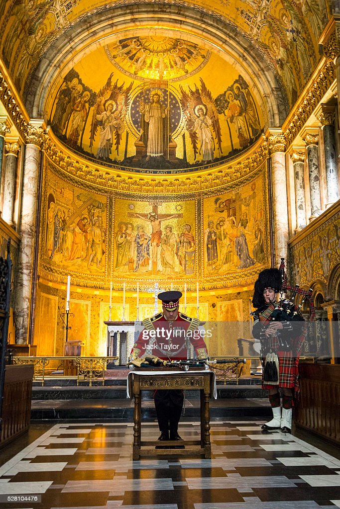 Band Master Will Casson-Smith lays a set of 100-year-old bagpipes as Piper Lance Sergeant John Mitchell (R) plays at The Guards Chapel, Wellington Barracks on May 4, 2016 in London, England. The bagpipes belonged to a Pipe Major of the Regiment of the Argyll and Sutherland Highlanders who died after becoming ill in the trenches at the Battle of the Somme. Later today they will be taken to Horse Guards Parade for a performance to launch the Household Division's Beating Retreat concerts, which feature military drills, music and fireworks, taking place on the 8th and 9th of June.
