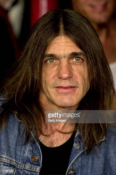 Band member Malcolm Young of the Australian rock band ACDC poses September 15 2000 at the Rock Walk handprint ceremony at the Guitar Center in...