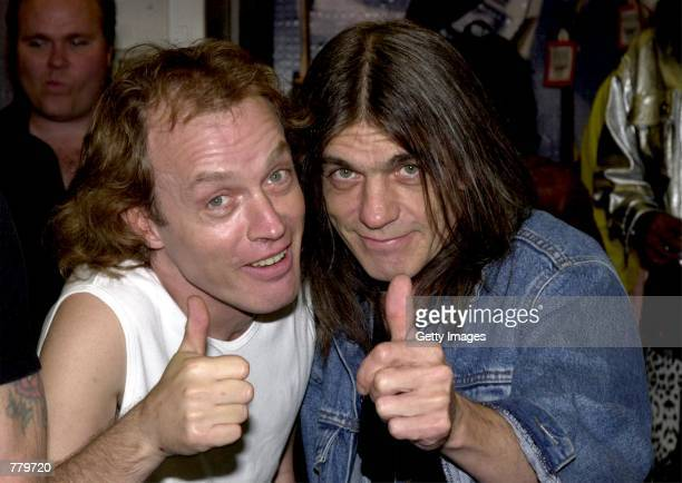 Band members Angus Young left and brother Malcolm Young of the Australian rock band ACDC pose September 15 2000 at the Rock Walk handprint ceremony...
