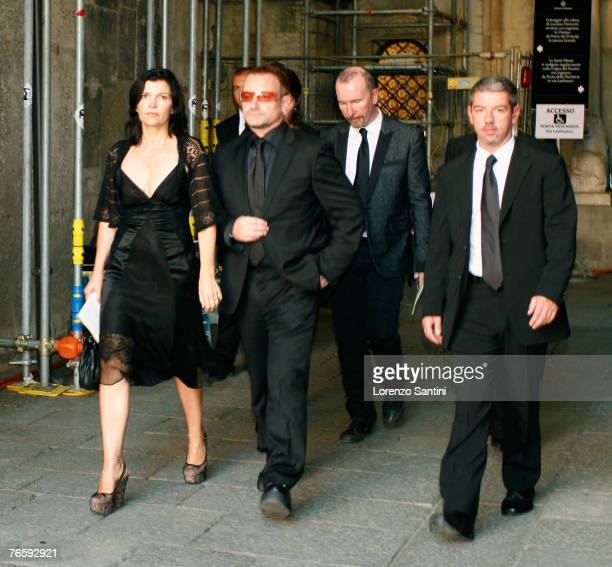 Band Members Bono and the Edge leave after the funeral of Italian tenor Luciano Pavarotti held in the Duomo di Modena on September 8 2007 in Modena...