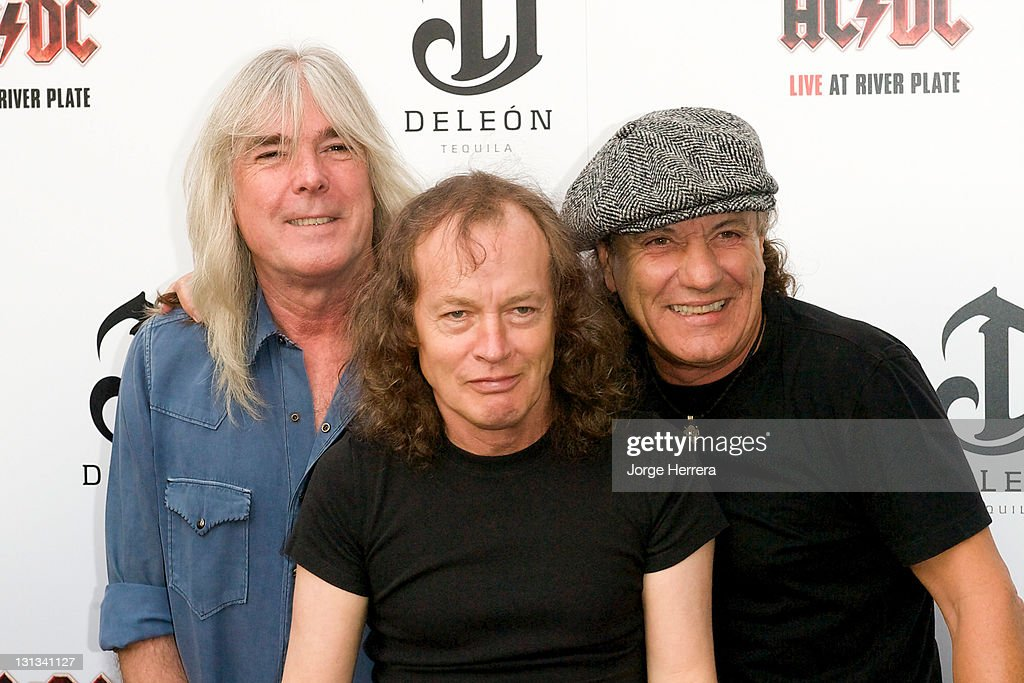 AC/DC band members Cliff Williams, Angus Young and Brian Johnson attend the Exclusive World Premiere Of AC/DC 'Live At River Plate' Presented By DeLeon Tequila at the HMV Apolo on May 6, 2011 in London, England.