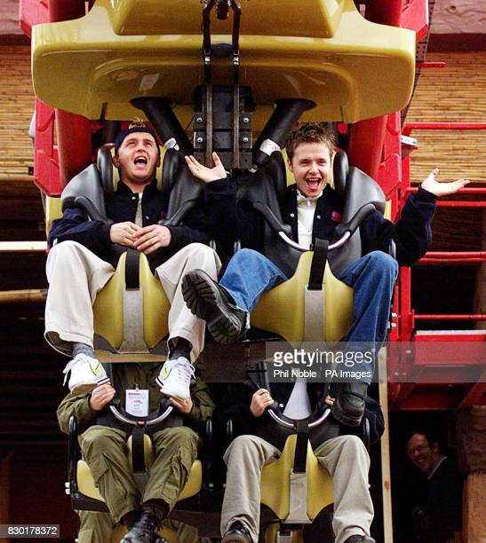 911 band members Jimmy Constable and Lee Brenan try out the new traumatizer ride at Southport Pleasure beach Britain's tallest and fastest suspended...