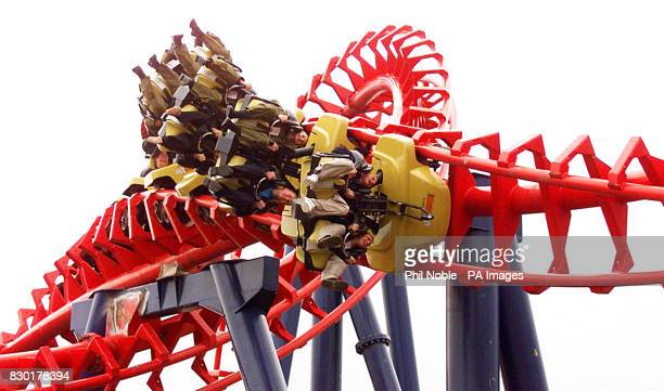 911 band members Jimmy Constable and Simon 'Spike' Dawbarn try out the new traumatizer ride Britain's tallest and fastest suspended looping roller...