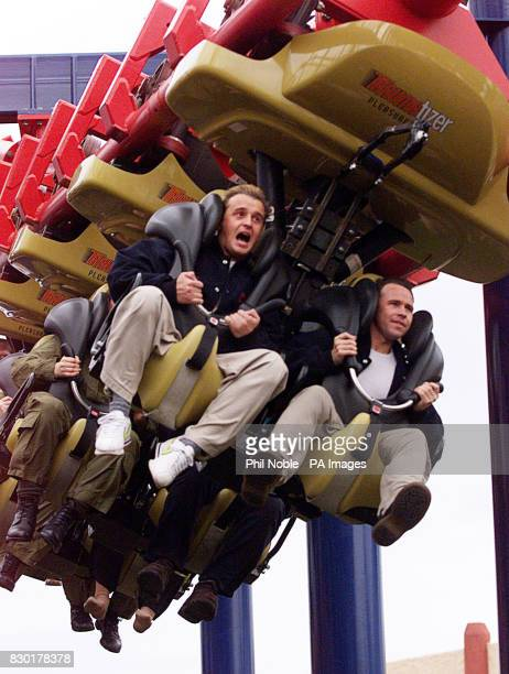 911 band members Jimmy Constable and Simon 'Spike' Dawbarn try the new traumatizer ride at Southport Pleasure beach Britain's tallest and fastest...
