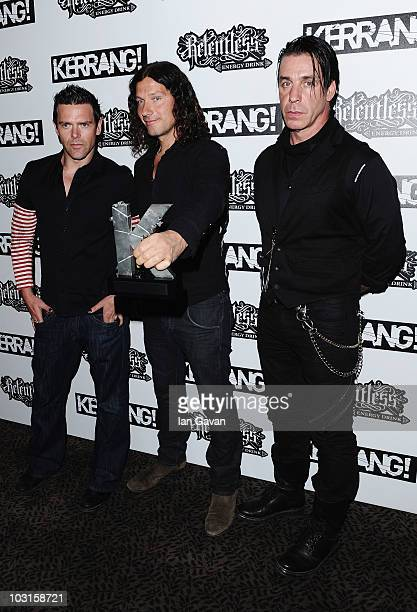 Band members of Rammstein winners of the Kerrang 'Inspiration Presented by MTV' award pose with their award during the Relentless Energy Drink...