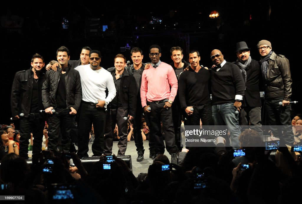 Band members of the New Kids On The Block, 98 Degrees, and Boyz II Men (L-R) Jeff Timmons, Jordan Knight, Jonathan Knight, Nathan Morris, Drew Lachey, Nick Lachey, Shawn Stockman, Joey McIntyre, Danny Wood, Wanya Morris, Justin Jeffre, and Donnie Wahlberg attend the New Kids On The Block Special Announcement at Irving Plaza on January 22, 2013 in New York City.