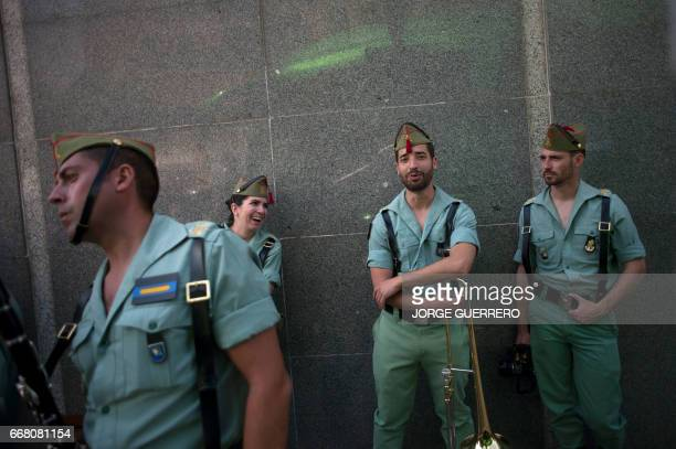 Band members of the Spanish Legion take a rest after a Holy Week procession on April 13 2017 in Malaga southern Spain Christian believers around the...
