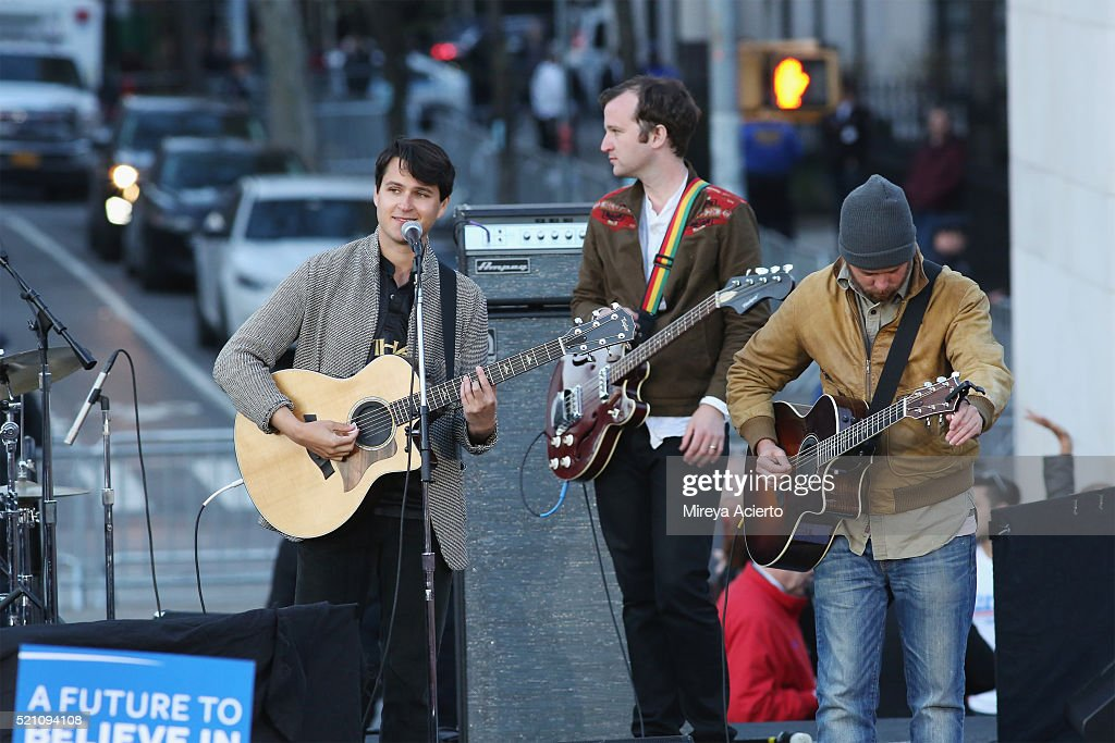 Band members of Vampire Weekend, Ezra Koenig (L) and Christopher Baio (C) perform during the Bernie Sanders rally at Washington Square Park on April 13, 2016 in New York City.